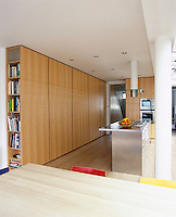 Floor to ceiling built in cupboards in this contemporary kitchen/dining area.