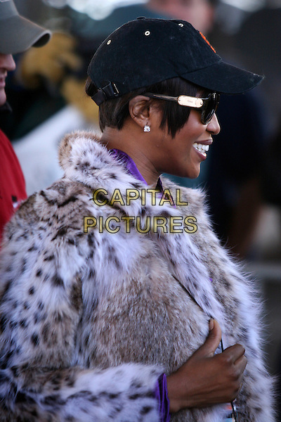 NAOMI CAMPBELL.Leaving  the Sanitation Department of New York on her fourth day of Community Service, New York, NY, USA.  .March 22nd, 2007.half length  leopard print fur jacket baseball cap hat sunglasses shades profile diamond earrings.CAP/IW.©Ian Wilson/Capital Pictures