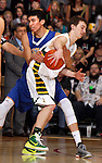 RAPID CITY, S.D. MARCH 20, 2015 -- Shilo Tallman #22 of Little Wound fouls Daniel Holmstrom #5 of Aberdeen Roncalli in the final minute during their semi-final game at the 2015 South Dakota State A Boys Basketball Tournament at the Don Barnett Arena in Rapid City, S.D.  (Photo by Dick Carlson/Inertia)