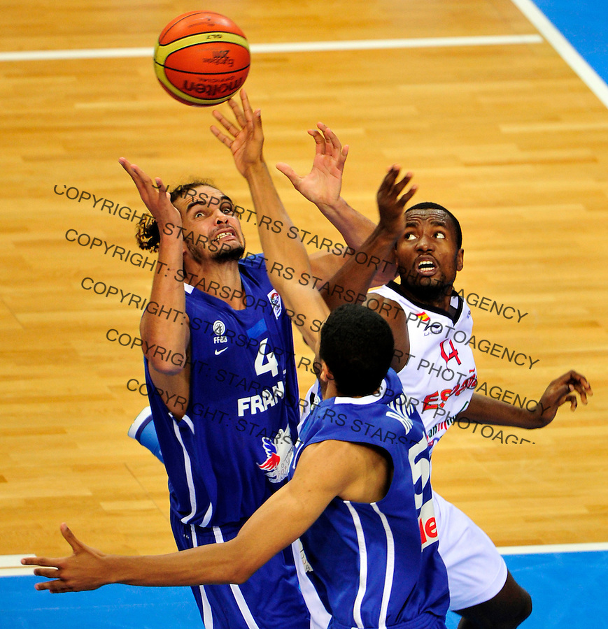 French national basketball team player Noah Joakim (4) fights for the ball with Spanish Ibaka Serge during final Eurobasket 2011 game between Spain and France in Kaunas, Lithuania, Sunday, September 18, 2011. (photo: Pedja Milosavljevic)