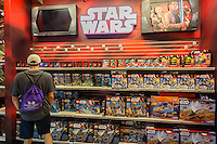 "Shoppers at the Toys R Us store in Times Square in New York on so-called ""Force Friday"", September 4, 2015. ""Force Friday"" is the name given by the Walt Disney Co. on the release of the Star Wars merchandise, three months prior to the release of the film. Disney acquired the Star Wars franchise in 2012 when it bought Lucasfilm for $4.1 billion. (© Richard B. Levine)"