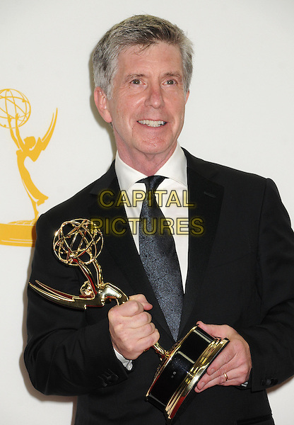 Tom Bergeron.64th Primetime Emmy Awards - press room - held at Nokia Theatre L.A. LIVE, Los Angeles, California, USA..23rd September 2012.pressroom emmys half length trophy winner black suit tie white shirt blue.CAP/ADM/BP.©Byron Purvis/AdMedia/Capital Pictures.
