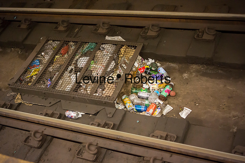 Litter is caught in a collection basket on the subway tracks in New York on Saturday, June 14, 2014. (© Richard B. Levine)