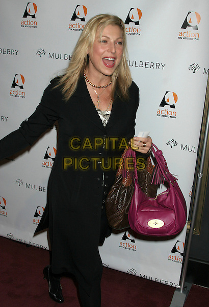 "TATUM ONEAL .""Gypsy of Chelsea"" Premiere at Studio 54 in New York.December 12th, 2005.Ref: IW.full length O'Neal cross crucifix necklace pink brown leather bags two purses black coat.www.capitalpictures.com.sales@capitalpictures.com.©Capital Pictures"