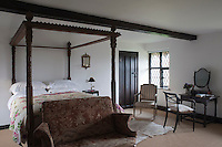 This bedroom is one of the more traditional rooms in the house and is furnished with an Elizabethan four-poster bed