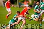 Brosna's Mike Finnegan been tackled by Anthony Kennedy of Listry in the Junior Premier Football Championship quarter final.