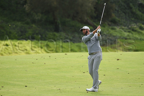 19th Februaru 2017, Pacific Palisades, CA, USA;  Dustin Johnson hits from the seventh hole fairway on his way to a win during the final round of the Genesis Open golf tournament at the Riviera Country Club on February 19, 2017.
