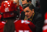 Coach Mark Johnson talks to players during a sweep of Minnesota in Minneapolis