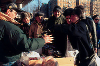 (950000-SWR03) - Brooklyn, New York - Russian immigrants line up in the cold to purchase borsch, sour creme, bread, and other staples, from a Russian merchant on Brighton Beach Avenue. All transactions are cnducted in Russian. Photo © Stacy Walsh Rosenstock