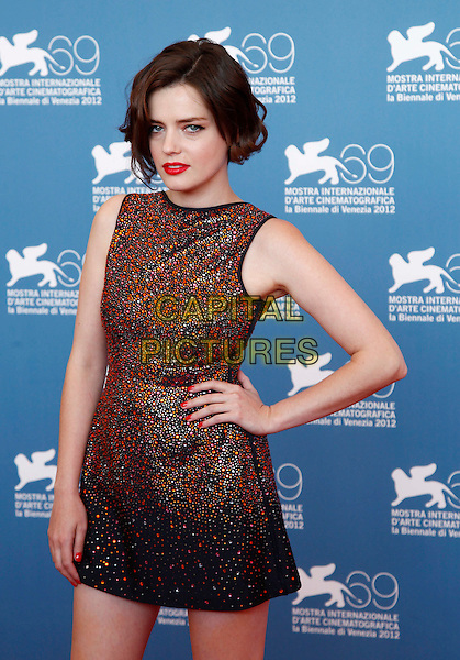 Roxane Mesquida.The 'Kiss of the Damned' Photocall during the 69th Venice Film Festival at the Palazzo del Casino, Venice, Italy..September 7th, 2012 .half length black silver orange sleeveless dress lipstick hand on hip.CAP/IPP/GR.©Gianluca Rona/IPP/Capital Pictures.