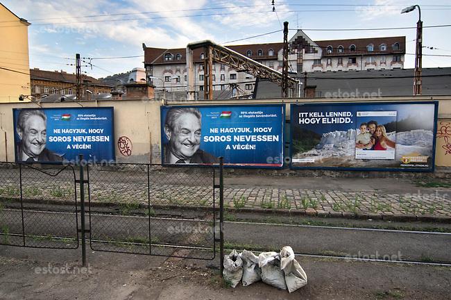 UNGARN, 07.2017, Budapest - VIII. Bezirk. Kampagne der Fidesz-Regierung gegen den US-ungarischen Juden, Finanzspekulanten und Foerderer einer offenen Gesellschaft, George Soros: &quot;Lassen wir nicht zu, dass Soros als Letzter lacht!&quot; Darueber in klein: &quot;99% (der Teilnehmer der Propaganda-Volksbefragung &quot;Nationale Konsultation&quot;) lehnen die illegale Einwanderung ab.&quot; Das Ungarn-Tourismus-Plakat rechts kommentiert: &quot;Du musst hier sein, um es zu glauben.&quot;   Fidesz government campaign against the US-Hungarian jew, financial speculator and supporter of an open society, George Soros: &quot;Let's not Soros have the last laugh!&quot;. Small letters: &quot;99% (of the participants of the propaganda-referendum called &quot;national consultation&quot;) oppose illegal immigration.&quot; To the right the Hungarian tourism campaign comments: &quot;To believe it you have to be here.&quot;<br /> &copy; Martin Fejer/estost.net