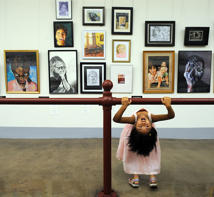 Alina Yang, 5, of West Chester, Pa., hangs out at the 2008 Congressional Art Competition in the tunnel between Cannon Building and the Capitol, June 25, 2008.  Her brother Xu Yang, 17, has an oil painting featured in the exhibit.