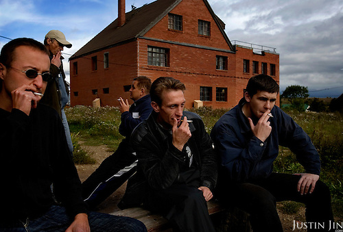 "Recovering alcoholics smoke during a break at the ""House of Hope on a Hill"" in a village outside St. Petersburg, Russia, where they attend a 28-day therapy..The centre, started by American Lou Bantle, treats alcoholics from all over Russia for free. .Alcoholism is a main cause of death in Russia."