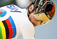 19 FEB 2012 - LONDON, GBR - Great Britain's Jason Kenny (GBR) watches Australia's Scott Sunderland (AUS) during their Men's Sprint 1/8 Final heat at the UCI Track Cycling World Cup final round in the Olympic Park Velodrome in Stratford, London, Great Britain .(PHOTO (C) 2012 NIGEL FARROW)