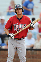 First baseman Tyler Kuresa (48) of the Elizabethton Twins bats in a game against the Johnson City Cardinals on Sunday, July 27, 2014, at Howard Johnson Field at Cardinal Park in Johnson City, Tennessee. The game was suspended due to weather in the fifth inning. (Tom Priddy/Four Seam Images)
