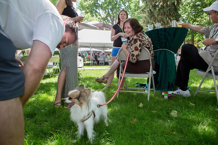 """Kip Botirius plays with a dog belonging to Sherry Browning-Rakatansky, center, during  a barbecue on the College Green on May 31, 2014. The event, for Ohio University alumni and their families, was part of the """"On The Green"""" weekend, which was hosted by the Ohio University Alumni Association. Photo by Lauren Pond"""