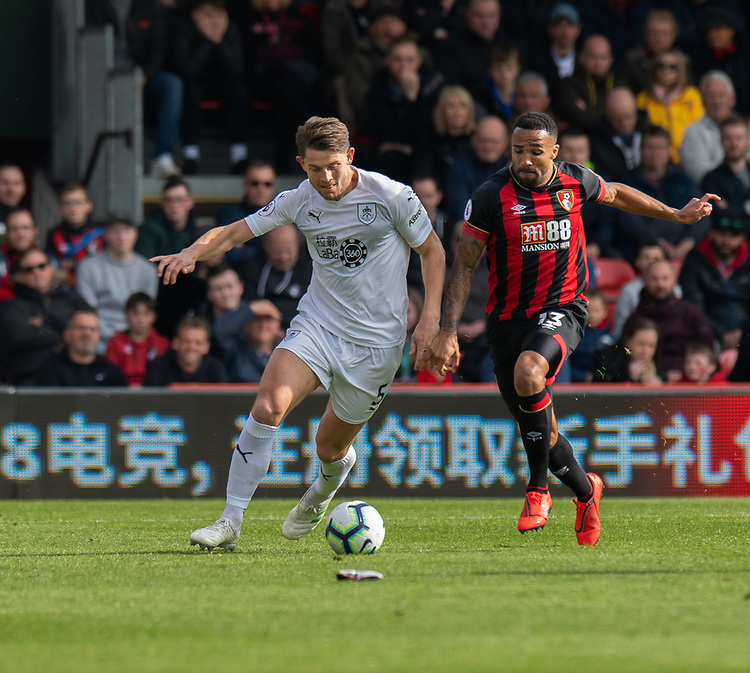 Burnley's James Tarkowski  (left) vies for possession with  Bournemouth's Callum Wilson (right) <br /> <br /> Photographer David Horton/CameraSport<br /> <br /> The Premier League - Bournemouth v Burnley - Saturday 6th April 2019 - Vitality Stadium - Bournemouth<br /> <br /> World Copyright © 2019 CameraSport. All rights reserved. 43 Linden Ave. Countesthorpe. Leicester. England. LE8 5PG - Tel: +44 (0) 116 277 4147 - admin@camerasport.com - www.camerasport.com