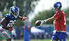 Eli Manning #10, New York Giants quarterback, right, hands off to running back Saquon Barkley #26 during training camp at Quest Diagnostics Training Center in East Rutherford, NJ on Friday, Aug. 3, 2018.