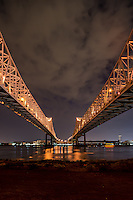 Mississippi river bridges in New Orleans or the Cresent bridge as a verticle image.