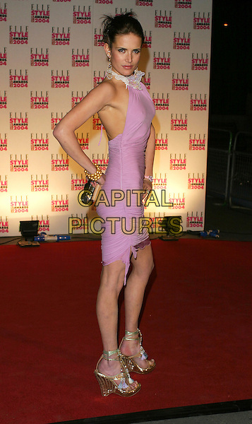 SOPHIE ANDERTON.Elle Style Awards at the Natural History Museum.16 February 2004.full length, full-length, thin, pink ruched halterneck dress, platform shoes, wedge heels, bruises.www.capitalpictures.com.sales@capitalpictures.com.©Capital Pictures