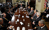 U.S. President George W. Bush participates in the National Security Advisor's Meeting with the United Nations Security Council Permanent Representatives in the Roosevelt Room of the White House in Washington, D.C. USA 25 June 2008. Zimbabwe's U.N. ambassador says a U.S. and British-led conspiracy fooled the U.N. Security Council into concluding the violence gripping his nation has made it impossible to hold a fair presidential election.<br /> Credit: Shawn Thew / Pool via CNP