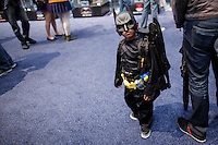 New York City, NY. 10 October 2014. A child dress up as Batman takes part during the 2014 New York Comic Con fair at the Jacob Javits Center. Photo by Kena Betancur/VIEWpress