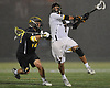 Chris Racalbuto #7 of Adelphi University, right, recoils for a shot which found the back of the net in the fourth quarter of a rain-filled first round game against Pace in the NCAA Division II Tournament at Motamed Field in Garden City, NY on Saturday, May 13, 2017.