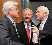 "Washington, DC - April 8, 2008 -- From left to right: United States Senators Edward M. ""Ted"" Kennedy, (Democrat of Massachusetts); Joseph I. Lieberman (Independent Democrat of Connecticut), and John McCain (Republican of Arizona) share a conversation prior to hearing the testimony of General David Petraeus and Ambassador Ryan Crocker before the United States Senate Armed Services Committee on the situation and progress in Iraq in Washington, D.C. on Tuesday, April 8, 2008..Credit: Ron Sachs / CNP"