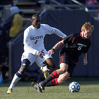 Northeastern University defender Jonathan Eckford (6) starts forward as University of Connecticut forward Allando Matheson (8) closes..NCAA Tournament. University of Connecticut (white) defeated Northeastern University (black), 1-0, at Morrone Stadium at University of Connecticut on November 18, 2012.