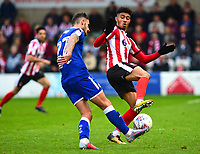 Lincoln City's Josh Ginnelly vies for possession with Chesterfield's Bradley Barry<br /> <br /> Photographer Andrew Vaughan/CameraSport<br /> <br /> The EFL Sky Bet League Two - Lincoln City v Chesterfield - Saturday 7th October 2017 - Sincil Bank - Lincoln<br /> <br /> World Copyright &copy; 2017 CameraSport. All rights reserved. 43 Linden Ave. Countesthorpe. Leicester. England. LE8 5PG - Tel: +44 (0) 116 277 4147 - admin@camerasport.com - www.camerasport.com