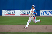 14 September 2009: Left fielder Hun-Gon Kim of South Korea runs the bases as he hits an homerun during the 2009 Baseball World Cup Group F second round match game won 15-5 by South Korea over Great Britain, in the Dutch city of Amsterdan, Netherlands.