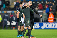 Manchester City manager Pep Guardiola congratulates David Silva at full time of the EPL - Premier League match between Swansea City and Manchester City at the Liberty Stadium, Swansea, Wales on 13 December 2017. Photo by Mark  Hawkins / PRiME Media Images.