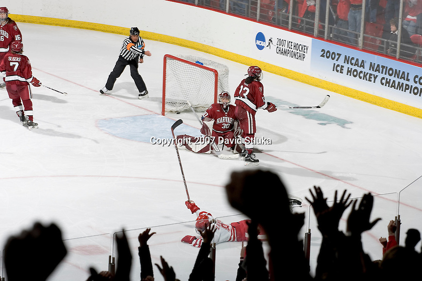 MADISON, WI - MARCH 10: Jinelle Zaugg #8 of the Wisconsin Badgers women's hockey team scores the winning goal in the 4th overtime against the Harvard Crimson during their NCAA tournament game at the Kohl Center on March 10, 2007 in Madison, Wisconsin. The Badgers beat the Crimson 1-0 in the 7th period. (Photo by David Stluka)