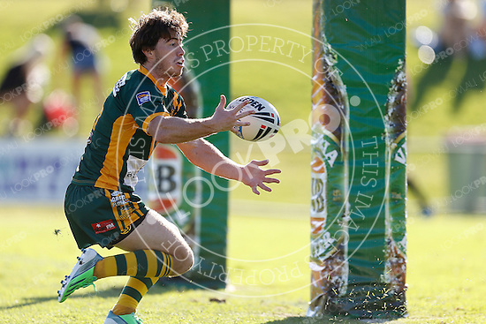 Mitch Williams of the Wyong Roos juggles the ball over the line during Round 5 of the 2013 NSW Cup against the Cronulla Sharks at Morrie Breen Oval on April 7, 2013 in Wyong, Australia. (Photo by Paul Barkley/LookPro)