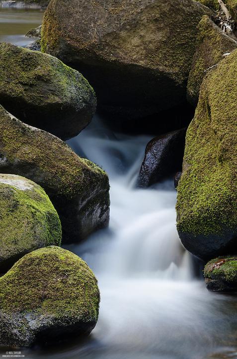 Water Flowing Between Rocks at Padley Gorge