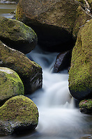 Water Flowing Between Rocks at Padley Gorge