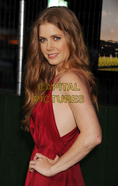 "Amy Adams.""Trouble With The Curve"" Los Angeles Premiere held at the Regency Village Theatre, Westwood, California, USA..September 19th, 2012.half length dress side hand on hip red .CAP/ROT/TM.©Tony Michaels/Roth Stock/Capital Pictures"