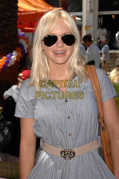 ANNA FARIS.Lollipop Theatre Network's Inaugural Game Day held At The Nickelodeon Animation Studios, Burbank, California, USA..May 3rd, 2009.half length blue dress brown bag purse sunglasses shades beige belt .CAP/ADM/KB.©Kevan Brooks/AdMedia/Capital Pictures.