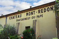 The winery building with a sign with text Chateau Mont-Redon Chateauneuf-du-Pape  Chateau Mont-Redon, Chateauneuf-du-Pape Châteauneuf, Vaucluse, Provence, France, Europe
