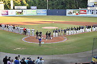 Teams lineup for the National Anthem before game 3 of the South Atlantic League Championship Series between the Asheville Tourists and the Hickory Crawdads on September 17, 2015 in Asheville, North Carolina. The Crawdads defeated the Tourists 5-1 to win the championship. (Tony Farlow/Four Seam Images)