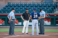 AZL Giants manager Hector Borg (13) meets with umpires Jeff Hamann (left) and Nathan Diederich, and AZL Brewers manager Rafael Neda (28) before an Arizona League game on August 15, 2017 at Scottsdale Stadium in Scottsdale, Arizona. AZL Giants defeated the AZL Brewers 4-3. (Zachary Lucy/Four Seam Images)