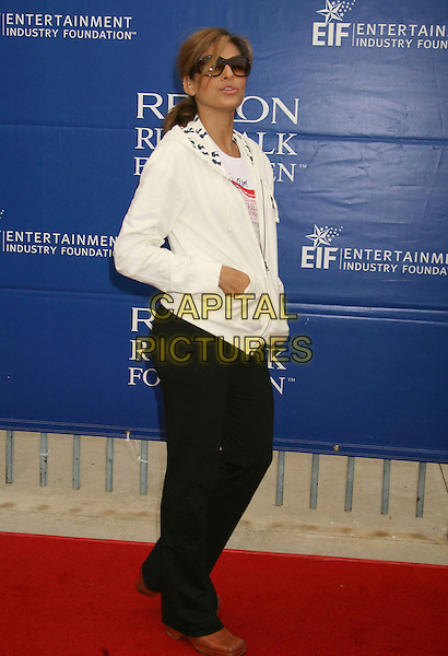EVA MENDES.14th Annual Entertainment Industry Foundation Revlon Run/Walk For Women held at The Los Angeles Memorial Coliseum, Los Angeles, California, USA,.12 May 2007..full length white hoodie top tracksuit trousers bottoms black sporty brown shoes.CAP/ADM/RE.©Russ Elliot/AdMedia/Capital Pictures.