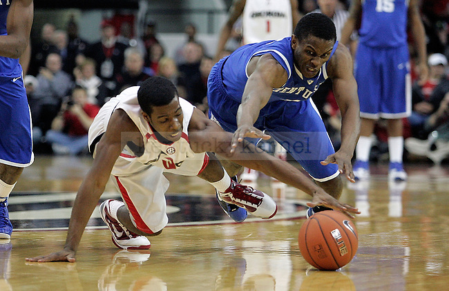 Sophomore guard Darius Miller fights Dustin Ware for possession of the ball in the first half of UK's 80-68 win over Georgia at Stegeman Coliseum  in Athens, GA on Wednesday, March 3, 2010. Photo by Britney McIntosh | Staff