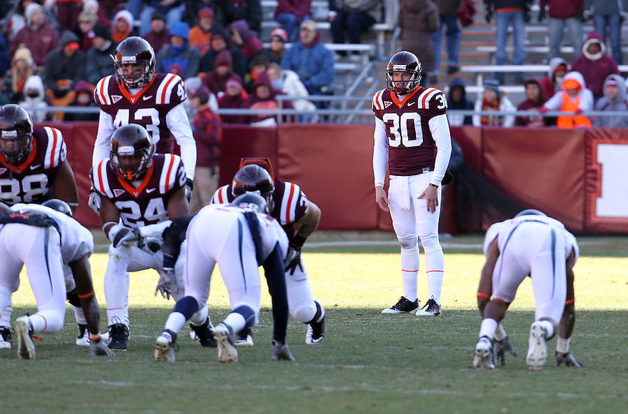 Nov 27, 2010; Charlottesville, VA, USA;  Virginia Tech Hokies punter Brian Saunders (30) during the game against the Virginia Cavaliers at Lane Stadium. Virginia Tech won 37-7. Mandatory Credit: Andrew Shurtleff