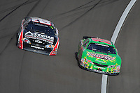 Mar 1, 2008; Las Vegas, NV, USA; Nascar Nationwide Series driver Kyle Busch (18) passes Steve Wallace (66) during the Sams Town 300 at the Las Vegas Motor Speedway. Mandatory Credit: Mark J. Rebilas-US PRESSWIRE