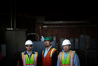 CREDIT: Daryl Peveto/LUCEO for The Wall Street Journal.Exports 2032..Los Angeles, California, March 1, 2010 - From left, a portrait of Emilio Razo, Daniel Torres and Luis M. Razo at the Los Angeles Harbor Grain Terminal. Demand for U.S. products is spiking in Asia, thanks to a weak dollar and quicker economic recovery. However, decline in U.S. consumption has left exports short of a good exit strategy. In 2009, imports fell 28%. This has created a bottleneck for exports, which need the shipping containers to move product overseas. ...