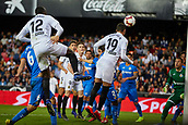 17th March 2019, Mestalla Stadium, Valencia, Spain; La Liga football, Valencia versus Getafe; Rodrigo Moreno of Valencia CF heads the ball challenged by Mouctar Diakhaby of Valencia CF goalkeeper David Soria and Leandro Cabrera of Getafe