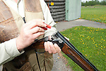 Unloading shotgun while skeet shooting