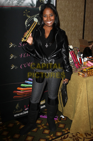 SHAR JACKSON.City of Hope Pre-Oscar gifting suite held At The Intercontinental Hotel, Century City, California, USA, 6th March 2010..full length black jacket boots jeans hair straighteners bum bag .CAP/ADM/KB.©Kevan Brooks/Admedia/Capital Pictures