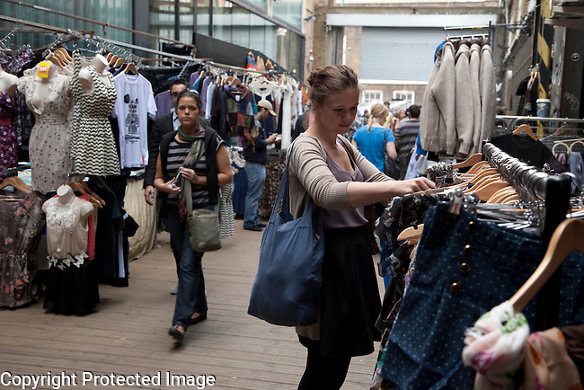 Young Woman Shopping in Sunday Up Market; Backyard Market; Brick Lane; London; England; UK